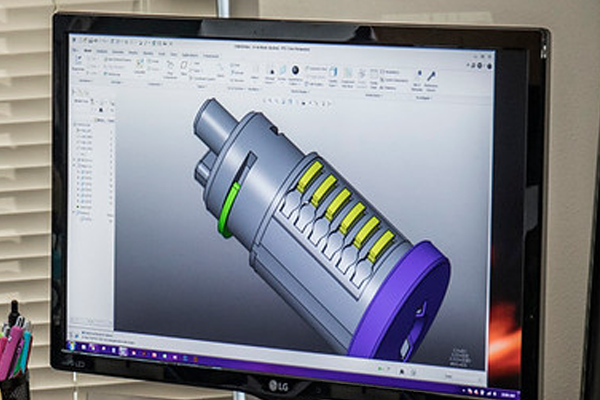 A picture of a monitor showing a CAD image